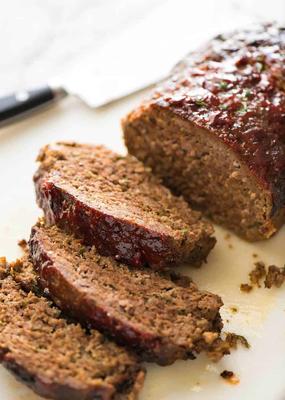 Meatloaf is so much more than a giant hunk of ground beef in a loaf shape. It should ooze with flavour, be moist and tender yet not crumble apart when sliced. www.recipetineats.com