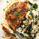Oven Baked Chicken Breast with Garlic Butter Kale on a dinner plate