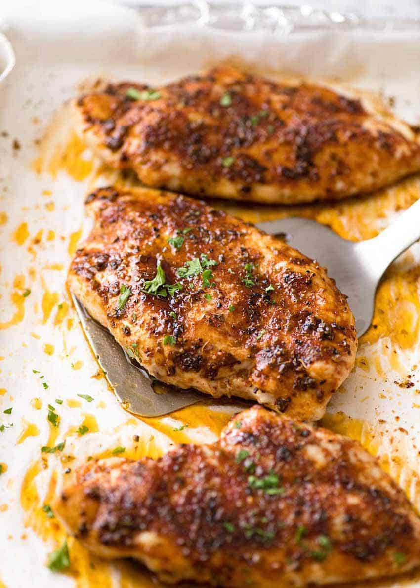 Juicy Oven Baked Chicken Breast on a tray, fresh out of the oven