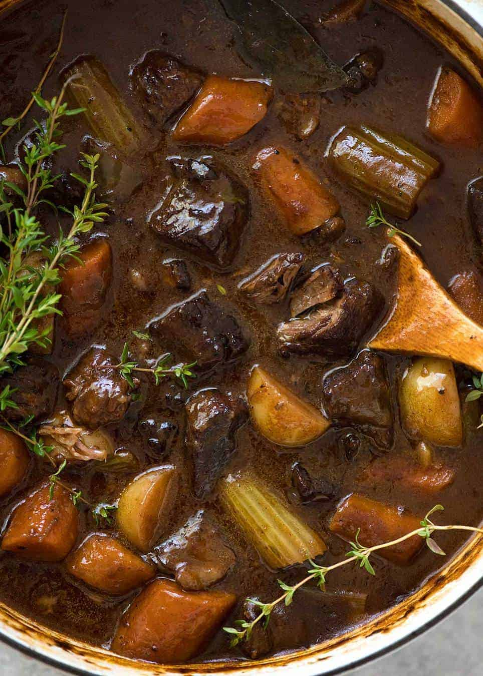 Overhead photo of Beef Stew with carrots and potatoes in a casserole pot.