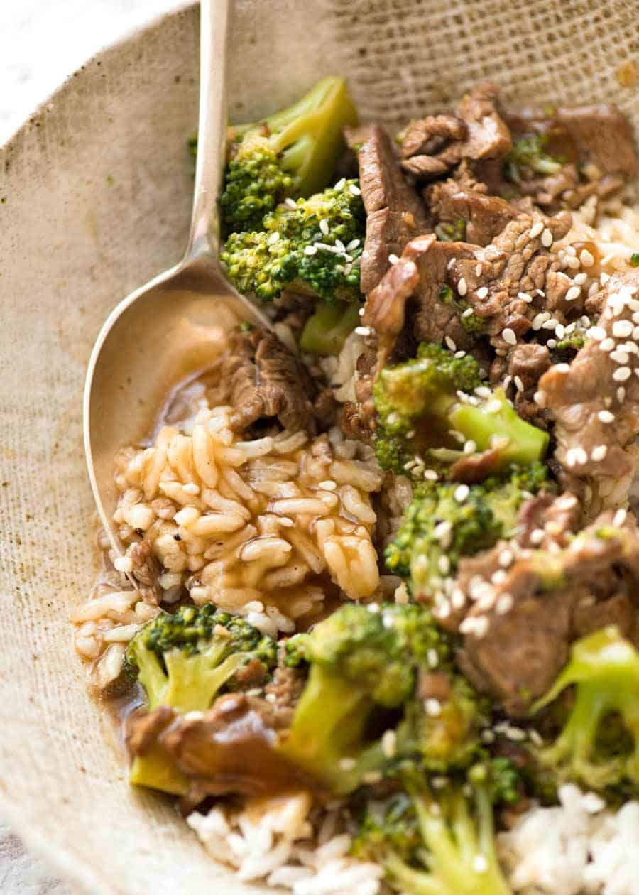 Close up showing sauce soaked rice in a bowl with Chinese Beef and Broccoli