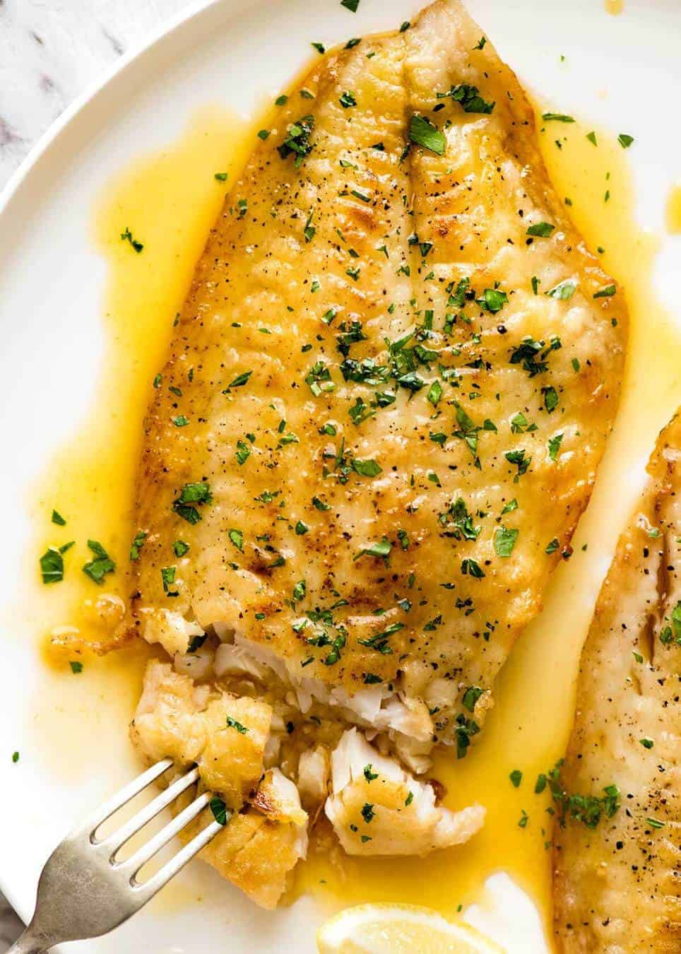 Killer lemon butter sauce for fish recipetin eats for Lemon fish sauce recipe