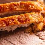 Close up of slices of Pork Roast with Crispy Crackling