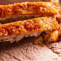 Close up of slices of Pork Roast with Crispy Crackling