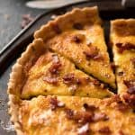 Photo of quiche lorraine on a rustic metal serving tray