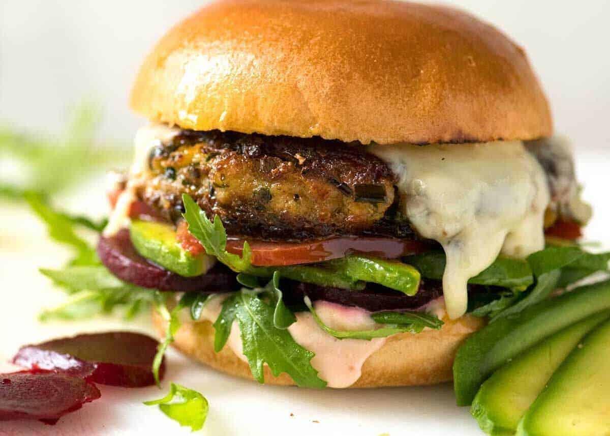 Veggie Burger with rocket, lettuce and tomato on a golden brioche bun