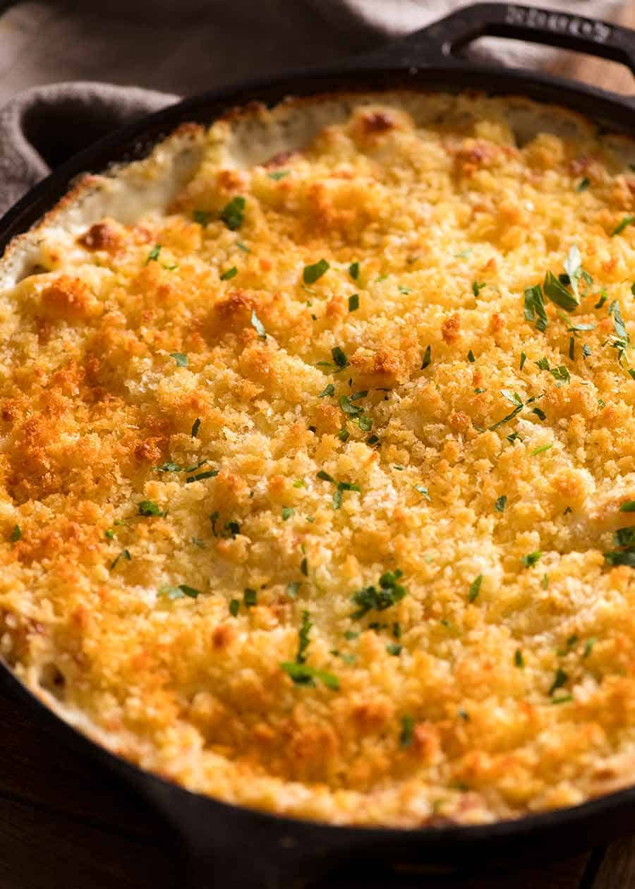 Baked Macaroni Cheese in a black skillet fresh out of the oven