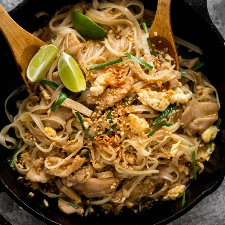 Chicken Pad Thai in a black skillet, fresh off the stove, ready to be served.