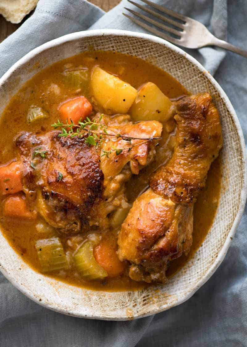 Chicken Stew in a rustic brown bowl, ready to be eaten