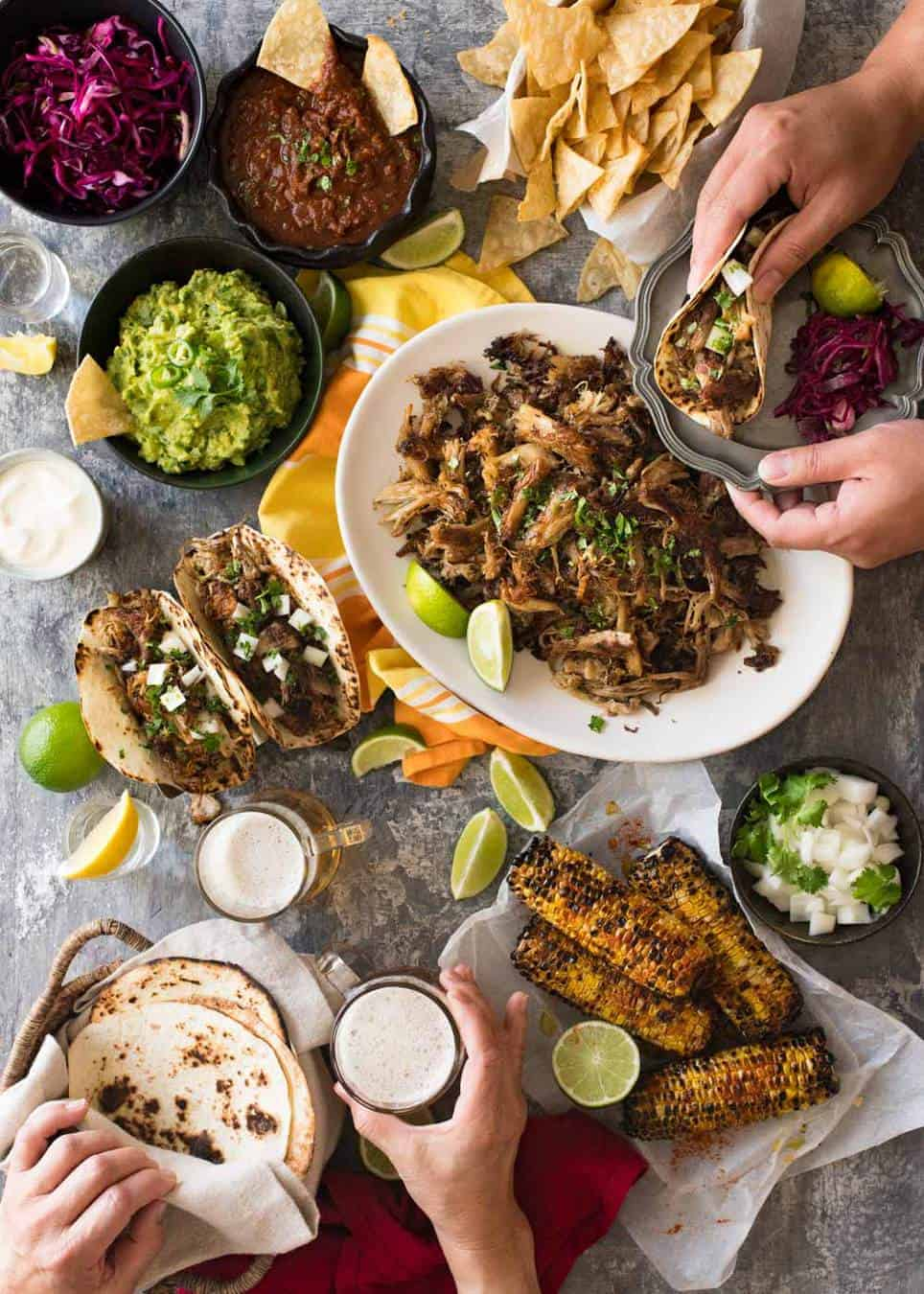 Overhead Photo Of Mexican Fiesta Taco Dinner Party With Pork Carnitas Tacos Grilled