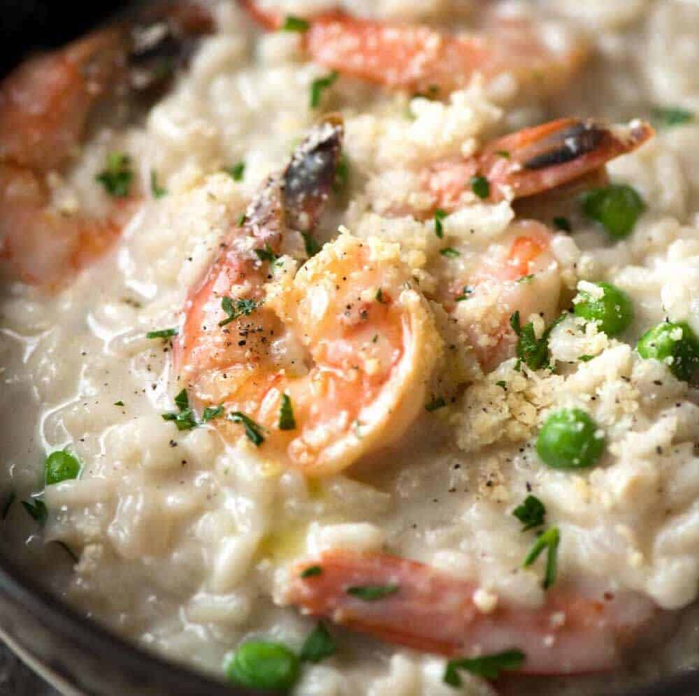 Close up of Prawn Risotto (Shrimp Risotto) in a dark brown bowl.