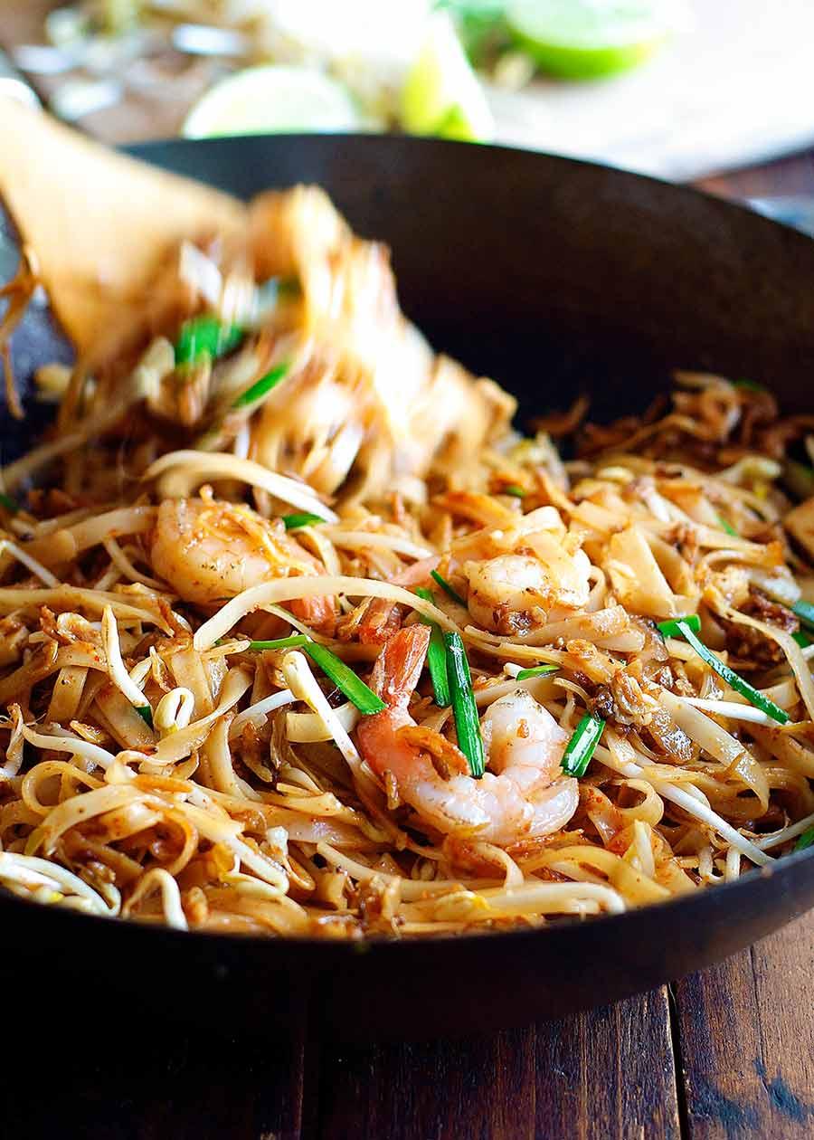 Tossing Shrimp Pad Thai in a wok