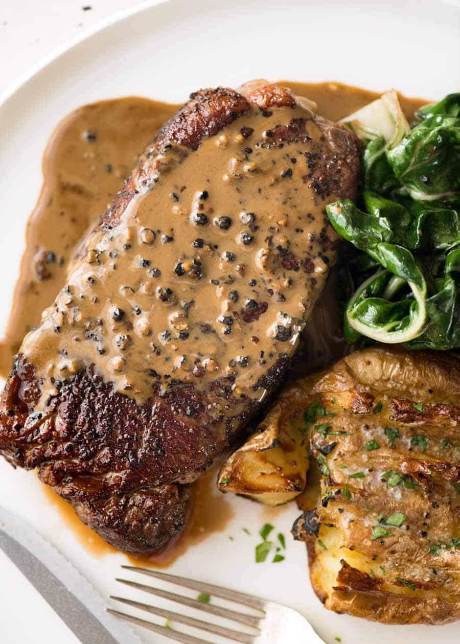 Steak With Creamy Peppercorn Sauce Recipetin Eats