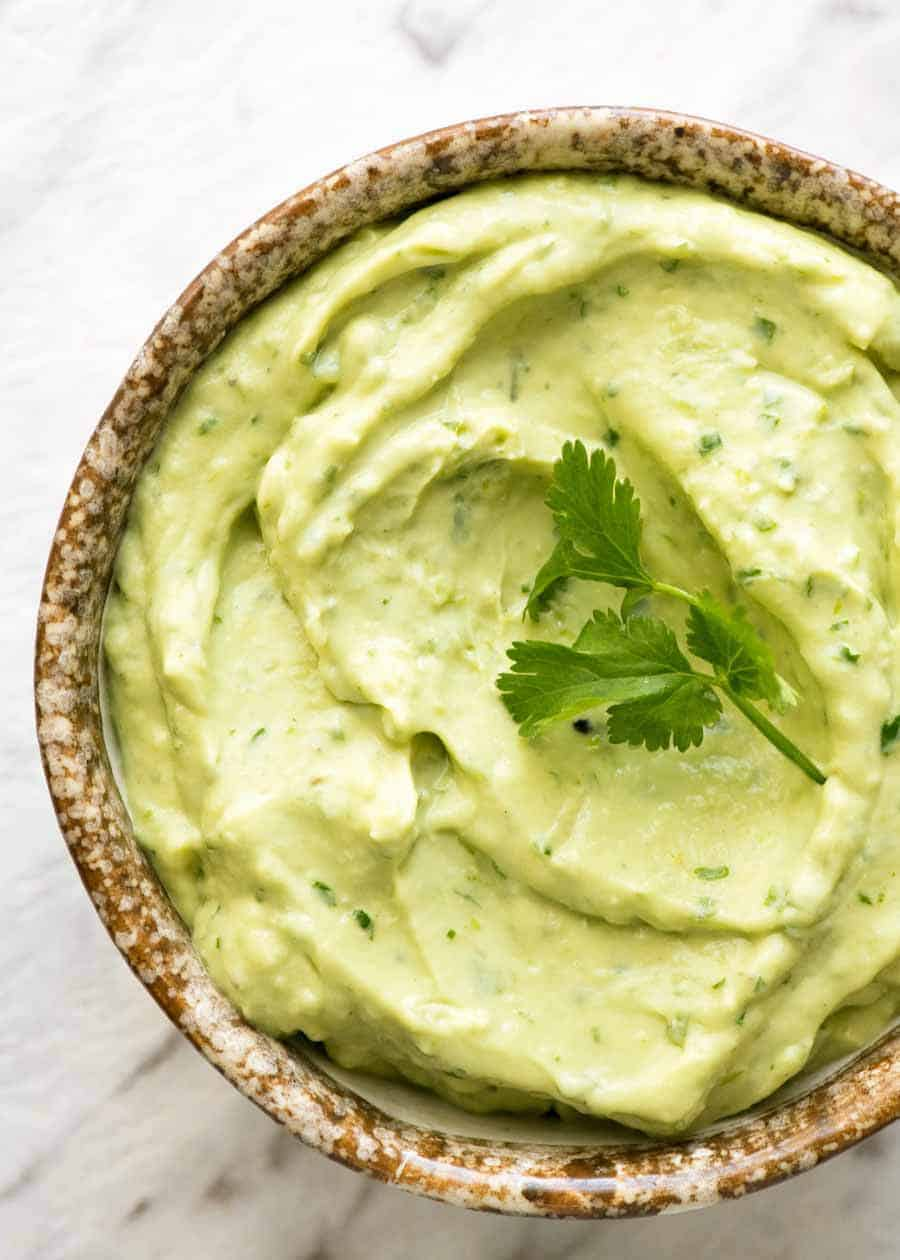 Overhead photo of Avocado Sauce in a rustic bowl.