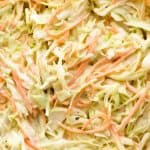 Close up of juicy Coleslaw in a glass bowl