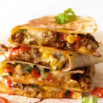 Stack of freshly cooked Quesadillas, crispy on the outside and molten cheesy goodness on the inside.