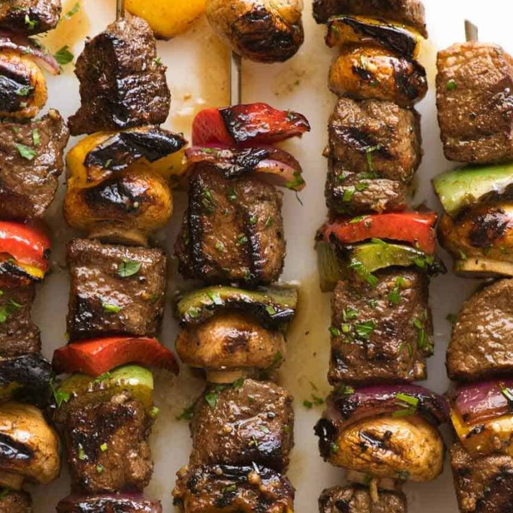 Overhead photo of Marinated Beef Kabobs with bell peppers, mushrooms and red onion