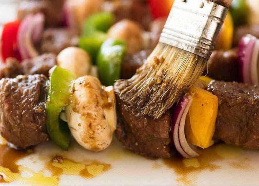 Brushing Beef Kabobs with marinade