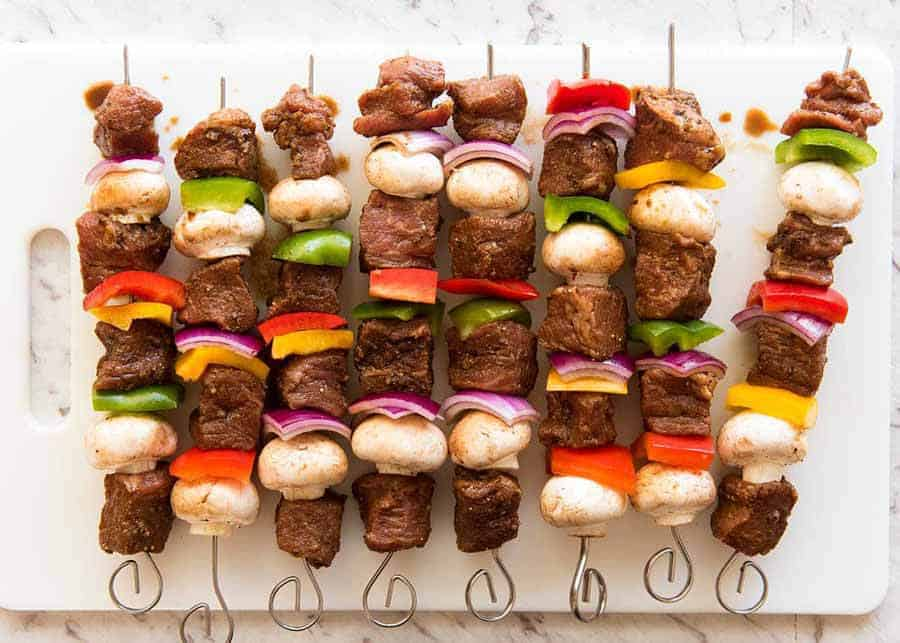 Photo of uncooked Marinated Beef Kabobs, ready to be cooked on the grill