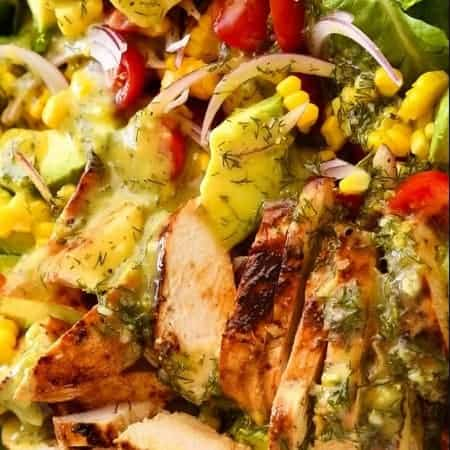 Close up of Lemon Chicken Salad with avocado, tomatoes and corn with lemon dill dressing.