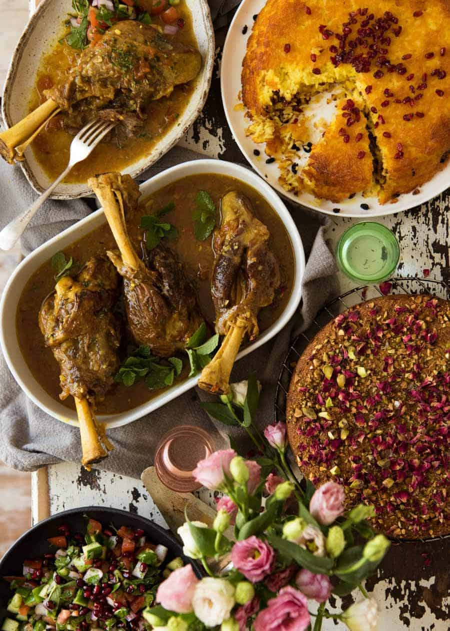 A table filled with Persian dinner recipes for Persian Feast week