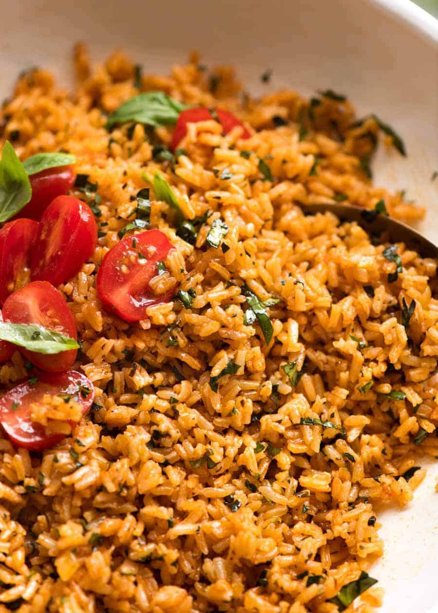 Close up of Tomato Basil Rice in a white bowl, ready to be served