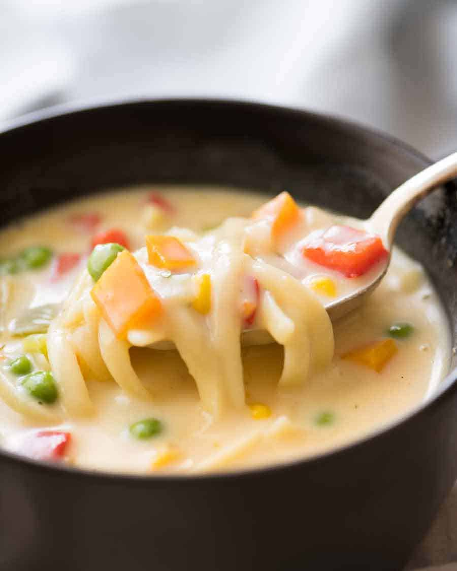 Spoon scooping up Cream of Vegetable Soup with Noodles (no cream!)