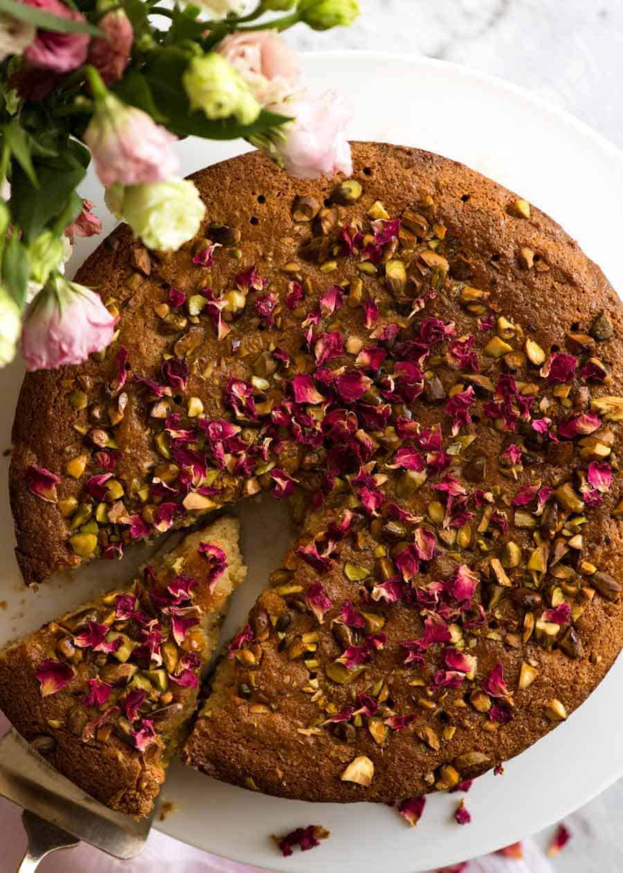 A beautiful Persian Love Cake that happens to be gluten free, made with semolina and almond meal. The best part is pouring the syrup over the cake so it soaks all the way through!
