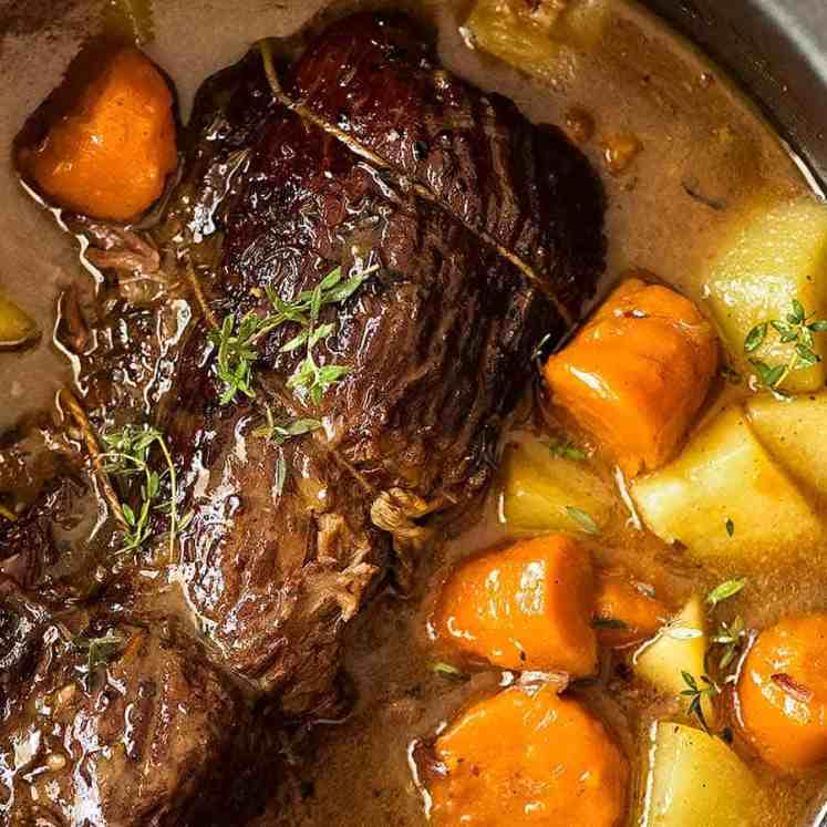 Slow Cooker Pot Roast in a slow cooker, ready to be eaten