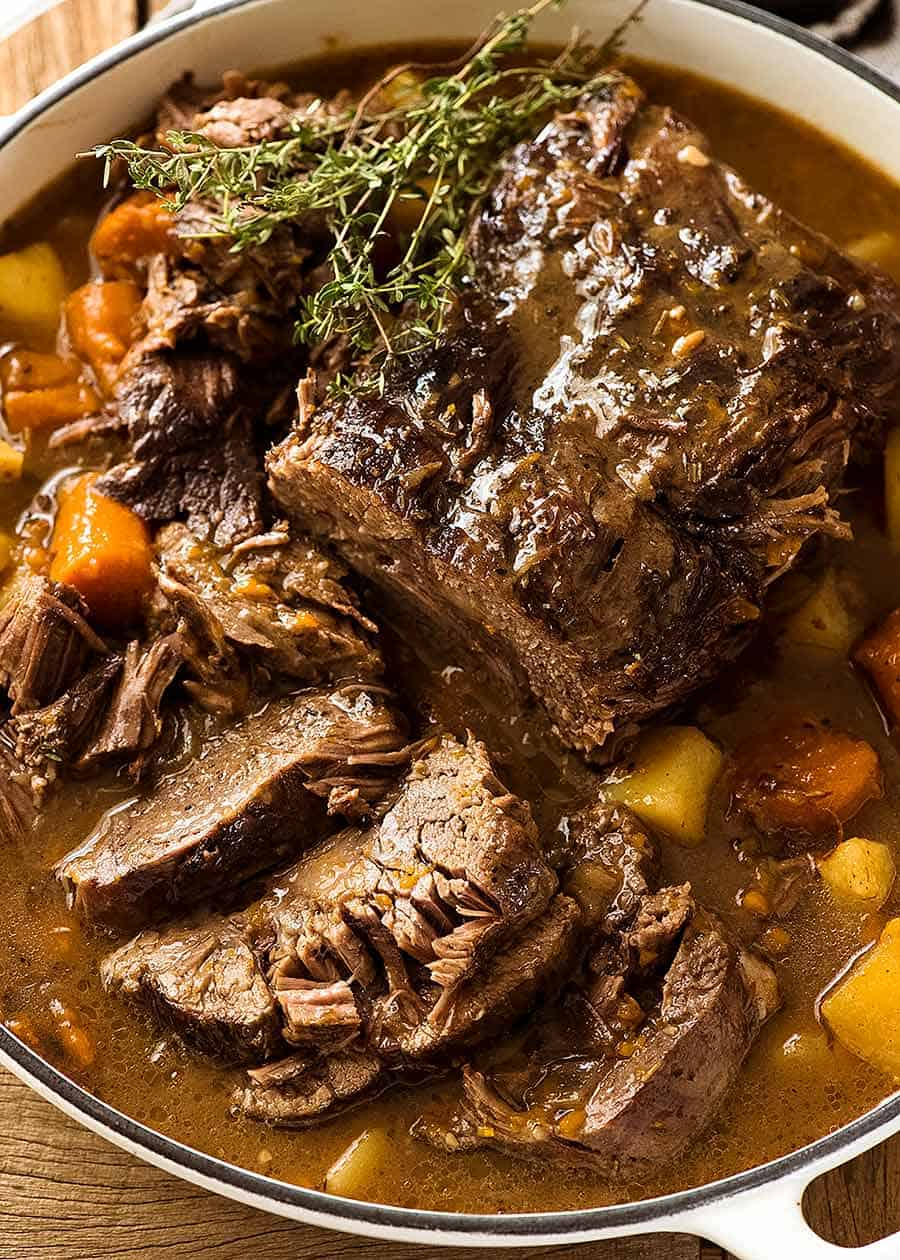 Slow Cooker Pot Roast in a casserole dish, ready to be served