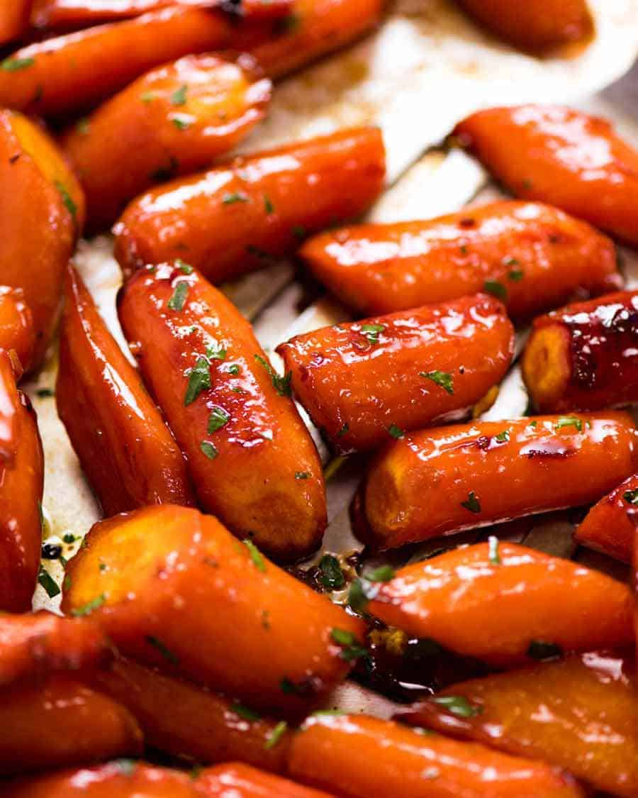 Close up of Brown Sugar Glazed Carrots on a tray, fresh out of the oven