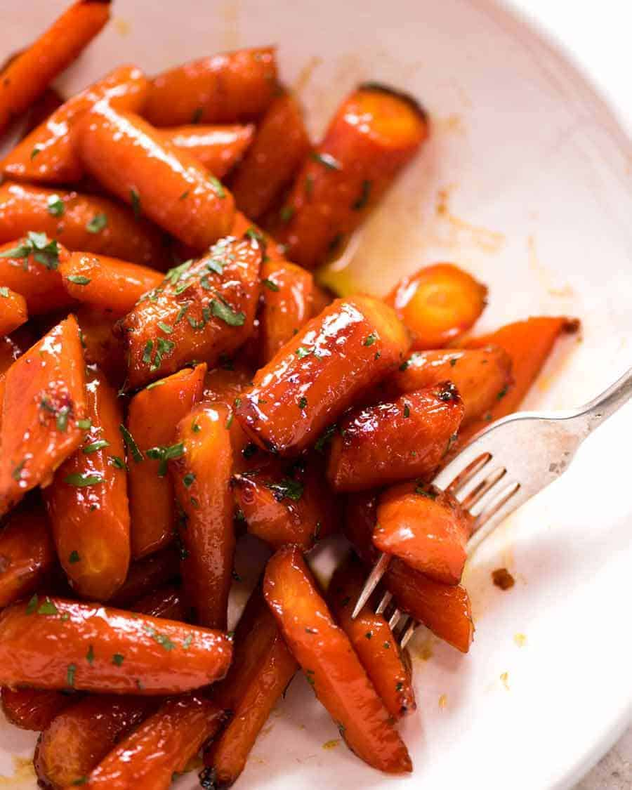 Brown Sugar Glazed Carrots in a white dish, ready to be served