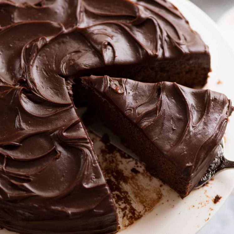 Easy Chocolate Fudge Cake being cut