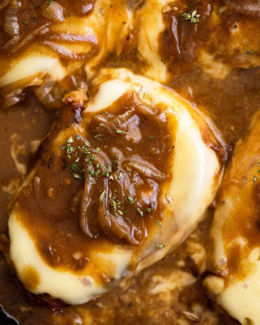 Overhead photo of French Onion Smothered Pork Chops in a skillet, fresh off the stove
