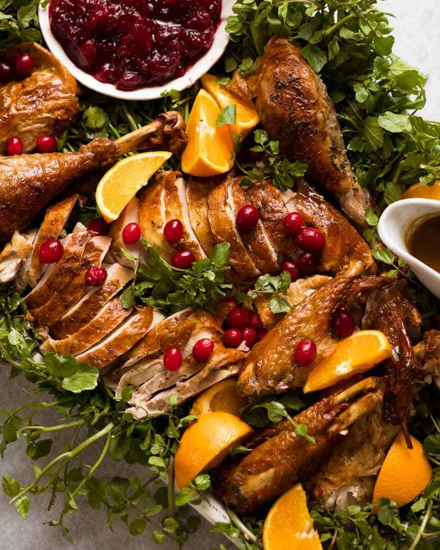 Platter of carved Juicy Roast Turkey, decorated platter ready for serving