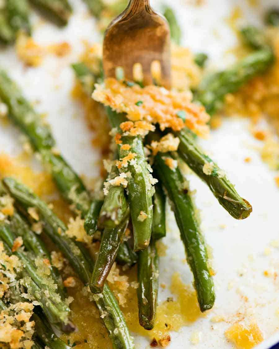 Close up of fork with Parmesan Roasted Green Beans