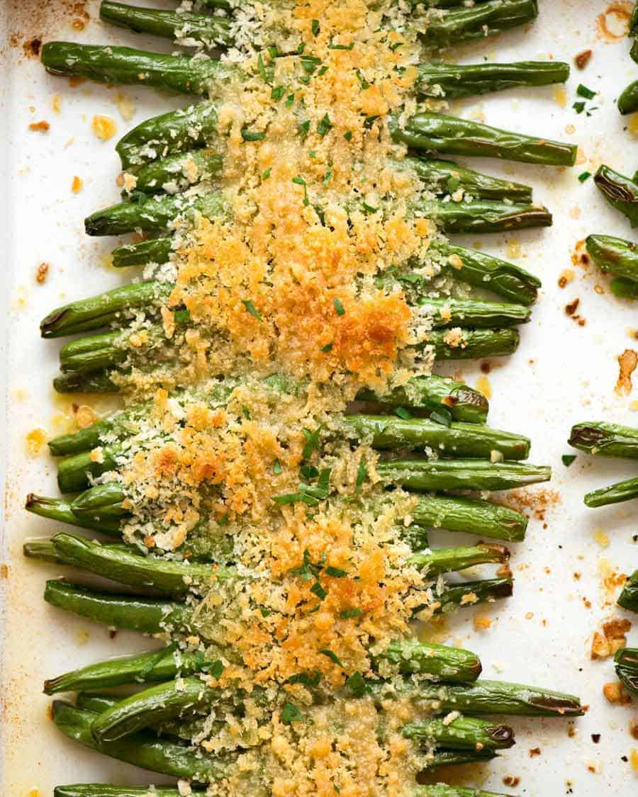 Overhead photo of Parmesan Roasted Green Beans on a tray, fresh out of the oven