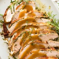 Slices of Slow Cooker Garlic Herb Turkey Breast on a plate, ready to be served