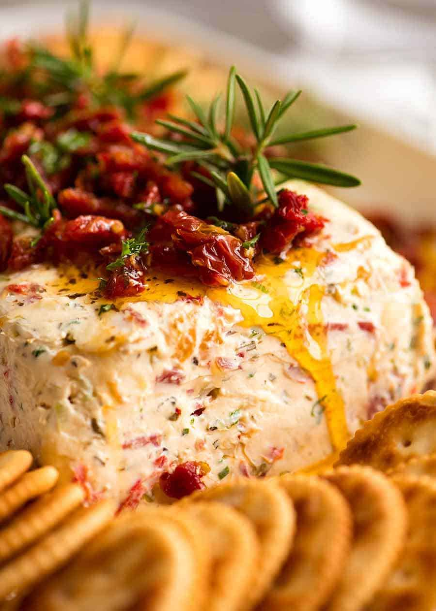 Close up of Christmas Appetiser Italian Cheese Log with sun dried tomato, festive starter for holiday entertaining.