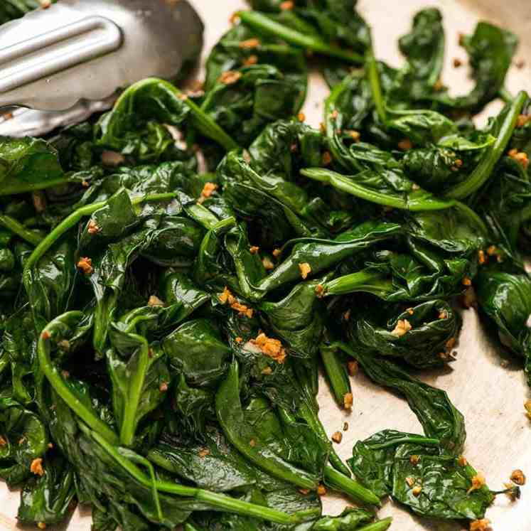 Garlic Sautéed Spinach in a skillet, ready to be served