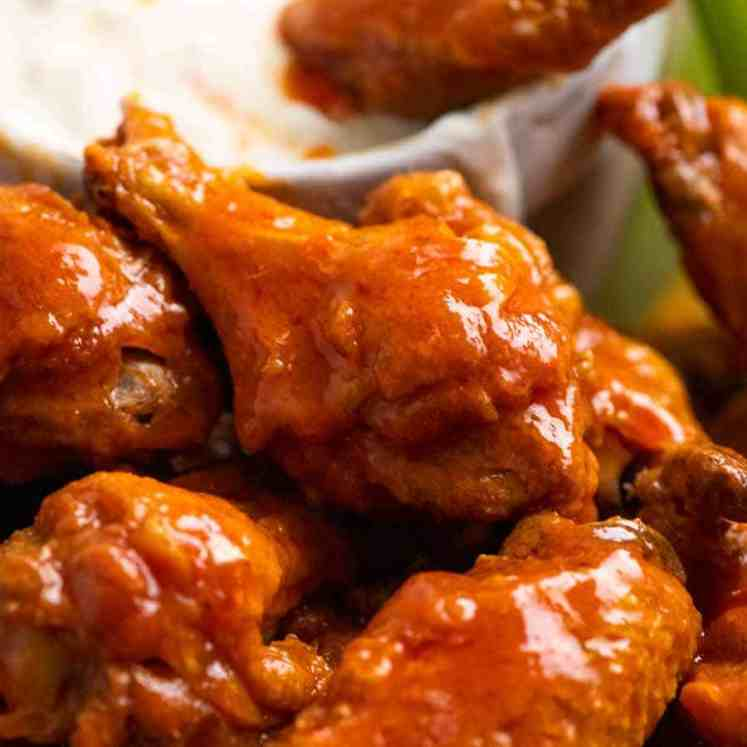 Close up of Buffalo Wings - crispy oven baked wings tossed in Buffalo Sauce