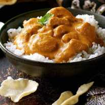 Butter Chicken served over basmati rice in a bowl, ready to be served