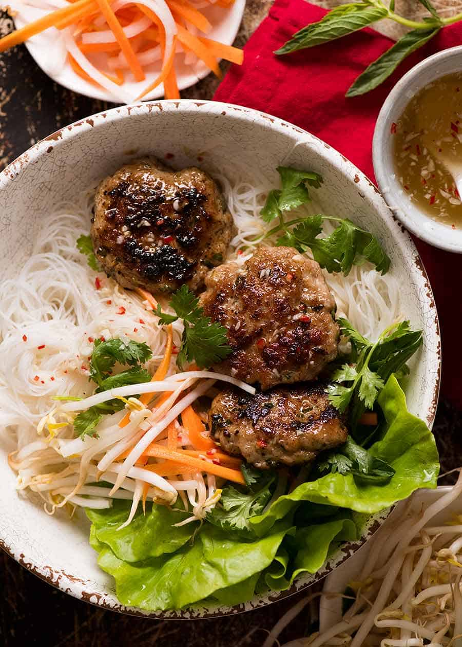 Overhead photo of Bun Cha - Vietnamese Meatballs in a bowl with noodles, ready to be eaten
