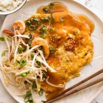 Egg Foo Young - Chinese Omelette on a plate served with rice, ready to be eaten