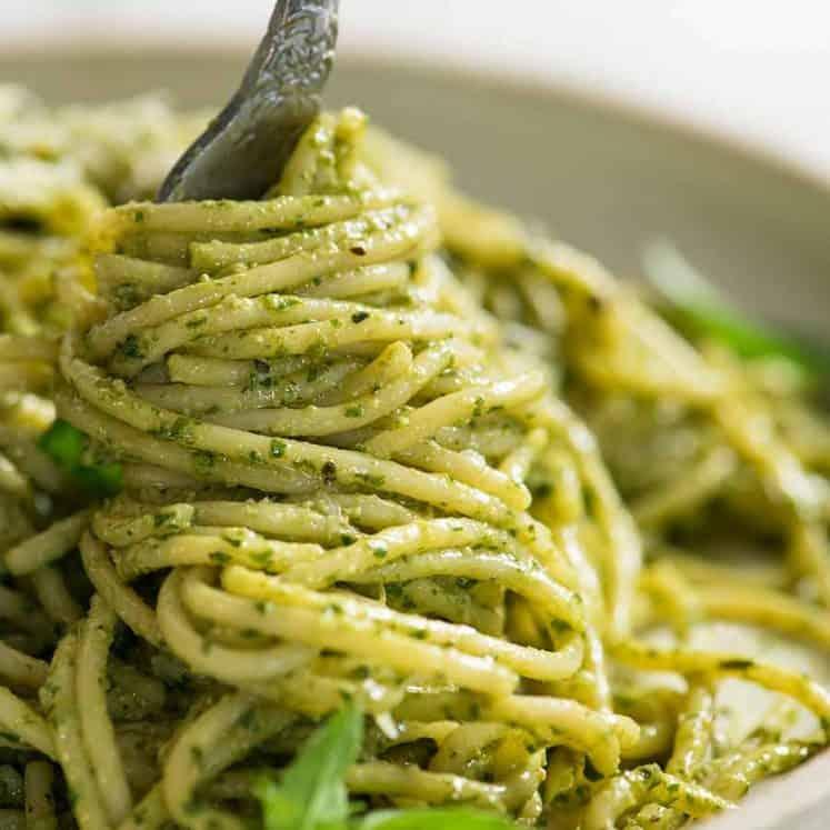Fork twirling pesto pasta