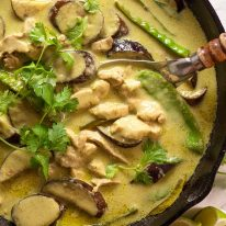 Thai Green Curry in a black skillet, fresh off the stove
