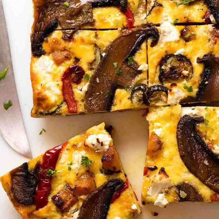 Overhead photo of Baked Frittata with Roasted Vegetables cut into slices, fresh out of the oven