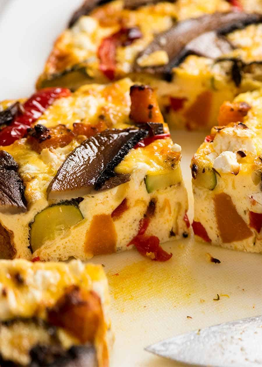 Close up of a slice of Baked Frittata with Roasted Vegetables