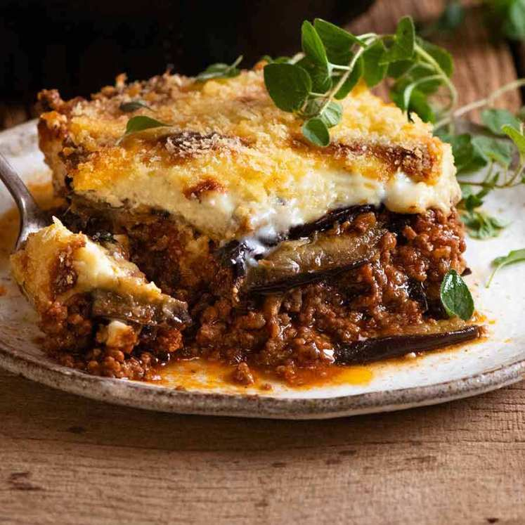 Close up photo of a slice of Greek Moussaka