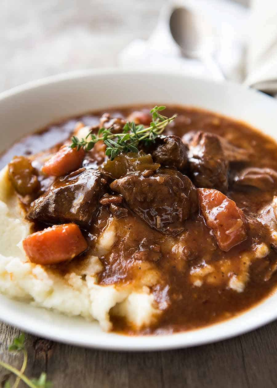 Photo of Irish Beef Guinness Stew over mashed potato, ready to be eaten